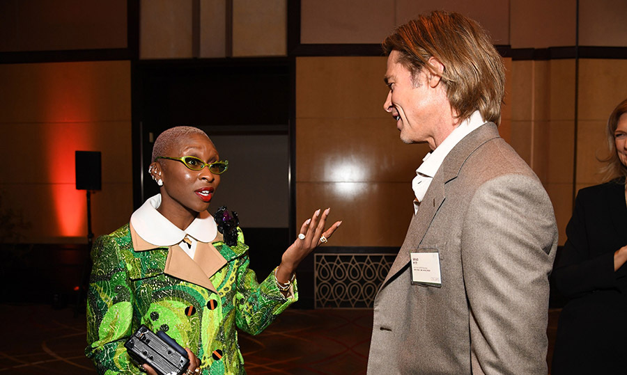 Cynthia Erivo, who is nominated for Best Actress and Best Original Song, talked to fellow nominee Brad Pitt. It looks like she is inspecting the <em>Once Upon a Time... in Hollywood</em> actor's name tag! <p>Photo: &copy; ROBYN BECK/AFP via Getty Images