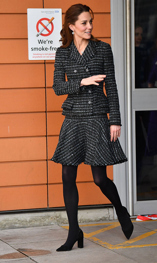 "<strong><a href=""https://ca.hellomagazine.com/tags/0/kate-middleton/"">Duchess Kate</a></strong> looked timeless and chic in a bouclé tweed skirt suit by <a href=""https://ca.hellomagazine.com/tags/0/dolce-gabbana/""><strong>Dolce & Gabbana</strong></a> at the Evelina London Children's Hospital on Jan. 28. She accessorized with black <a href=""https://ca.hellomagazine.com/tags/0/Gianvito-Rossi""><strong>Gianvito Rossi</strong></a> heels and <strong>Mappin & Webb</strong> drop earrings. The suit is something she has worn before! <p>Kate was at the hospital to join a creative workshop run by the National Portrait Gallery's Hospital Programme. <p>Photo: &copy; BEN STANSALL/AFP via Getty Images"