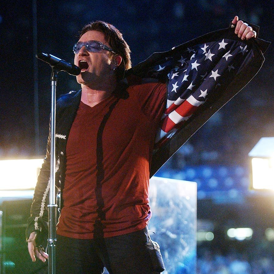 <strong><a href=/tags/0/u2>U2</a></strong>'s 2002 set featured a stirring tribute to those who lost their lives in the 9/11 attacks, including singer <strong>Bono</strong> flashing his jacket lining, which featured the print of an American flag.