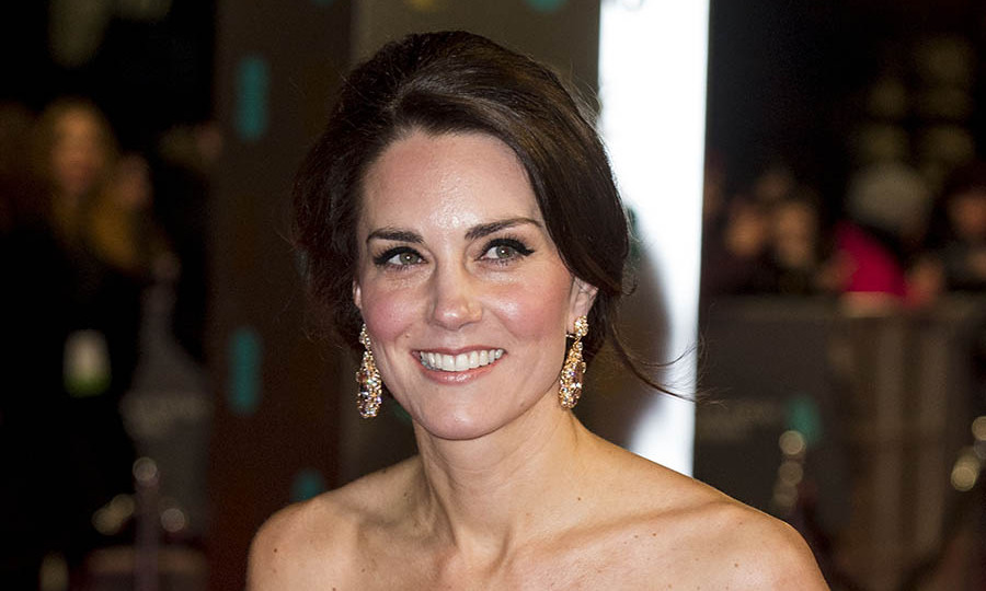 The off-the-shoulder neckline of Kate's dress was made for these bold earrings. <p>Photo: &copy; Mark Cuthbert/UK Press via Getty Images