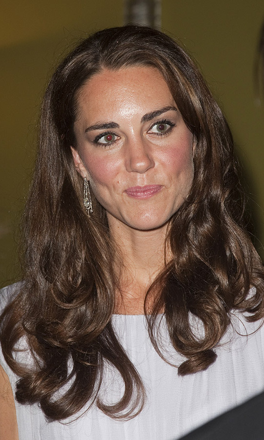 At the event in Los Angeles, the duchess wore her hair in soft waves. Her sparkling dangling earrings were still evident beneath her swirling strands. <p>Photo: &copy; POOL - Julian Parker/UK Press via Getty Images