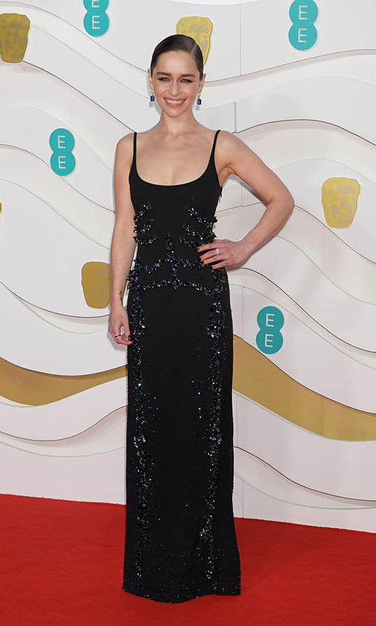 Former <em>Game of Thrones</em> actress <a href=/tags/0/emilia-clarke><strong>Emilia Clarke</strong></a> enlivened a minimalist black gown with textured embellishment. <p>Photo: &copy; David M. Benett/Dave Benett/Getty Images