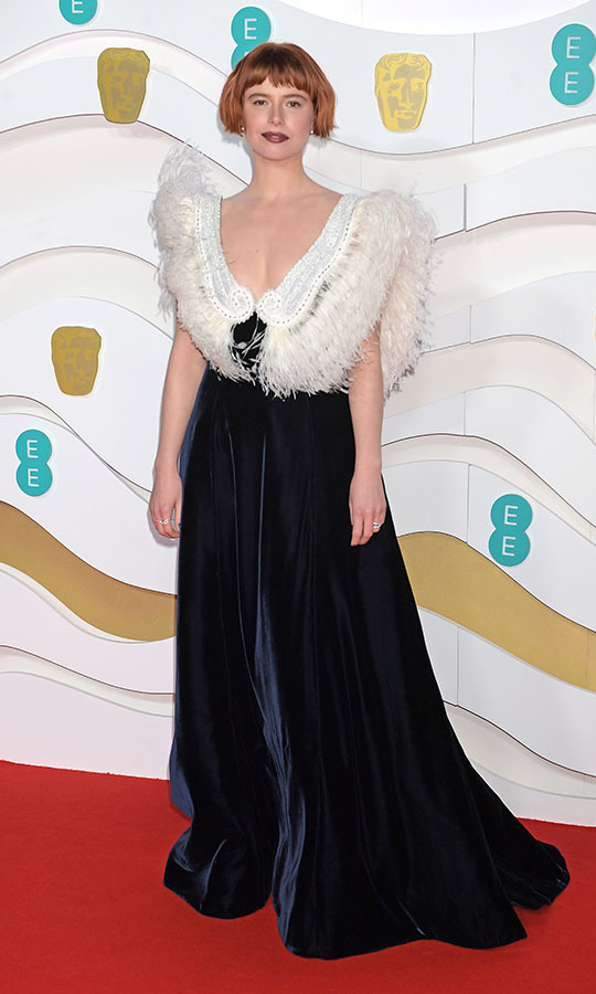 Best Leading Actress nominee <strong>Jessie Buckley </strong> brought some vintage flair in a dramatic gown with navy velvet skirt and feathered bodice. <p>Photo: &copy; David M. Benett/Dave Benett/Getty Images