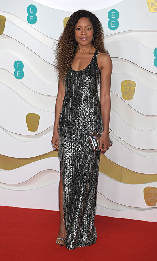 Into 2020! <em>James Bond</em> actress <strong>Naomie Harris</strong> looked like a modern flapper with her silver maxi dress with fringing. <p>Photo: &copy; David M. Benett/Dave Benett/Getty Images