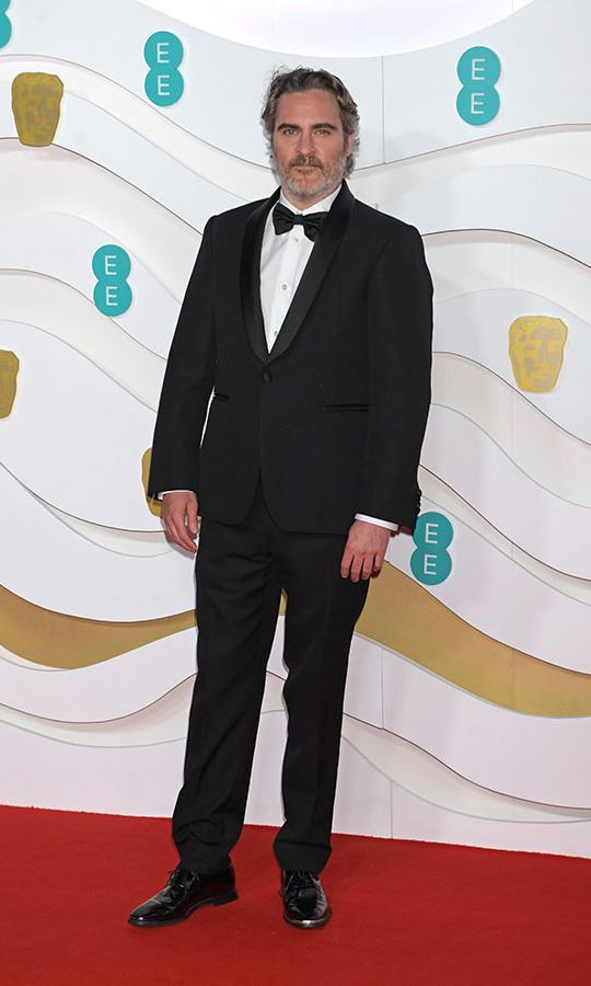Best Leading Actor nominee <a href=/tags/0/joaquin-phoenix><strong>Joaquin Phoenix</strong></a> went for a classic look in a black tux with white button-down. <p>Photo: &copy; David M. Benett/Dave Benett/Getty Images
