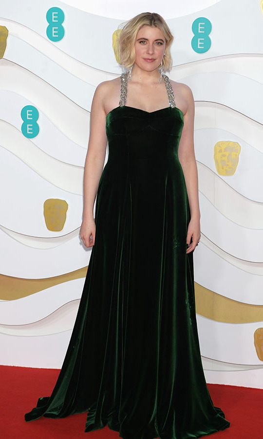 <em>Little Women</em> director <a href=/tags/0/greta-gerwig><strong>Greta Gerwig</strong></a> exuded elegance in a deep emerald green velvet gown featuring embellished straps. <p>Photo: &copy; David M. Benett/Dave Benett/Getty Images