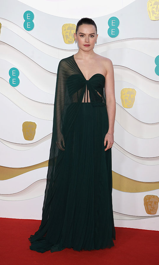 <em>Star Wars</em> actress <a href=/tags/0/daisy-ridley><strong>Daisy Ridley</strong></a> defined modern elegance in this unique gown with half-cape. <p>Photo: &copy; David M. Benett/Dave Benett/Getty Images