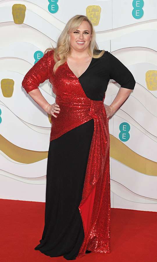 <a href=/tags/0/rebel-wilson><strong>Rebel Wilson</strong></a> looked sensational in a black and shimmering red wrap dress. <p>Photo: &copy; David M. Benett/Dave Benett/Getty Images