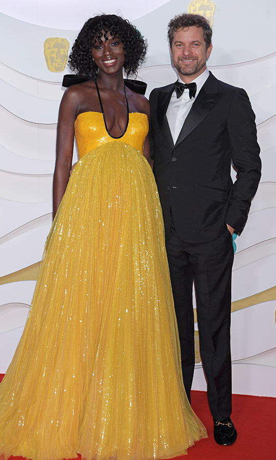 An expectant <strong>Jodie Turner-Smith</strong> and <a href=/tags/0/joshua-jackson><strong>Joshua Jackson</strong></a> were all smiles on the red carpet. She radiated in her shimmering yellow dress. <p>Photo: &copy; David M. Benett/Dave Benett/Getty Images