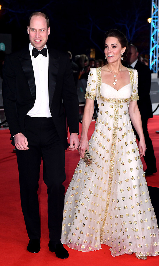 Kate looked incredible in a custom <strong><a href=/tags/0/alexander-mcqueen>Alexander McQueen</a></strong> gown that we last saw her wear while she visited Malaysia with William in 2012. Back then, the duchess wore the gorgeous creation to a state dinner hosted by The Agong, Malaysia's King. 