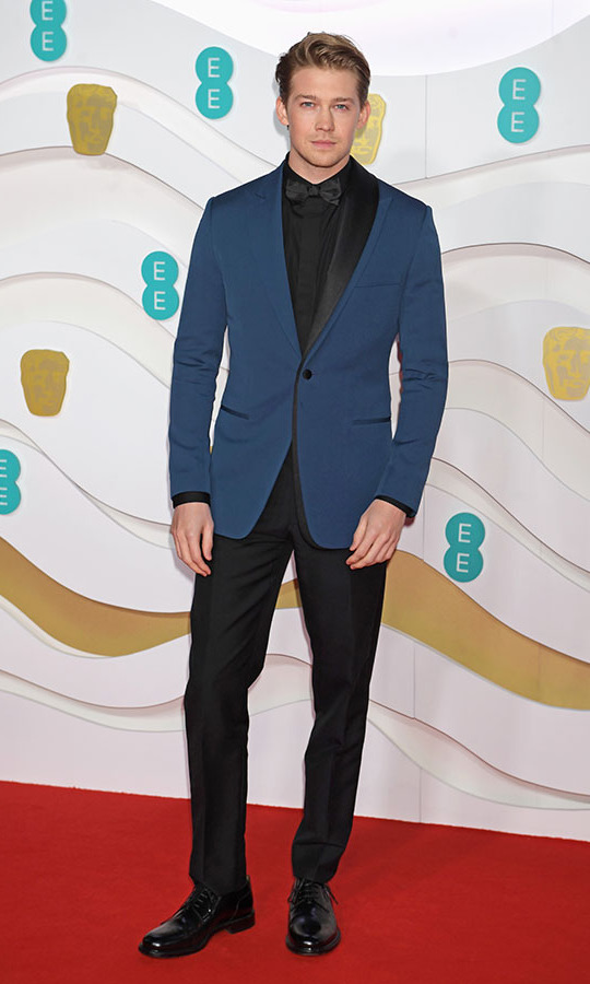 British actor <strong>Joe Alwyn</strong> brought some blue to the BAFTAs red carpet with his modern suit. <p>Photo: &copy; David M. Benett/Dave Benett/Getty Images