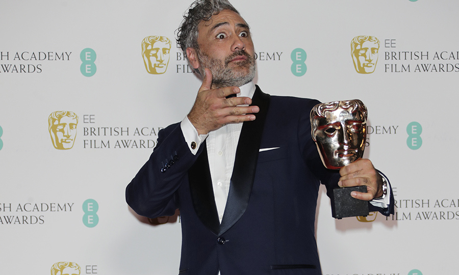<strong><a href=/tags/0/taika-waititi>Taika Waititi</a></strong> hammed it up with his award for Best Adapted Screenplay for <i>Jojo Rabbit</i> in the winners room.