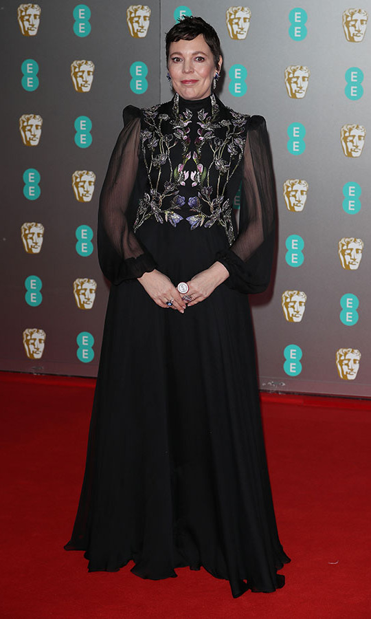 <a href=/tags/0/olivia-colman><strong>Olivia Colman</strong></a>'s regal black gown was accented with floral embroidery. <p>Photo: &copy; Neil Mockford/FilmMagic