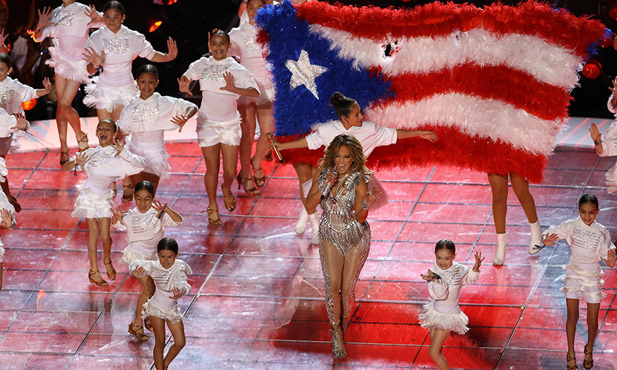 J.Lo was wrapped in a huge Puerto Rican flag!