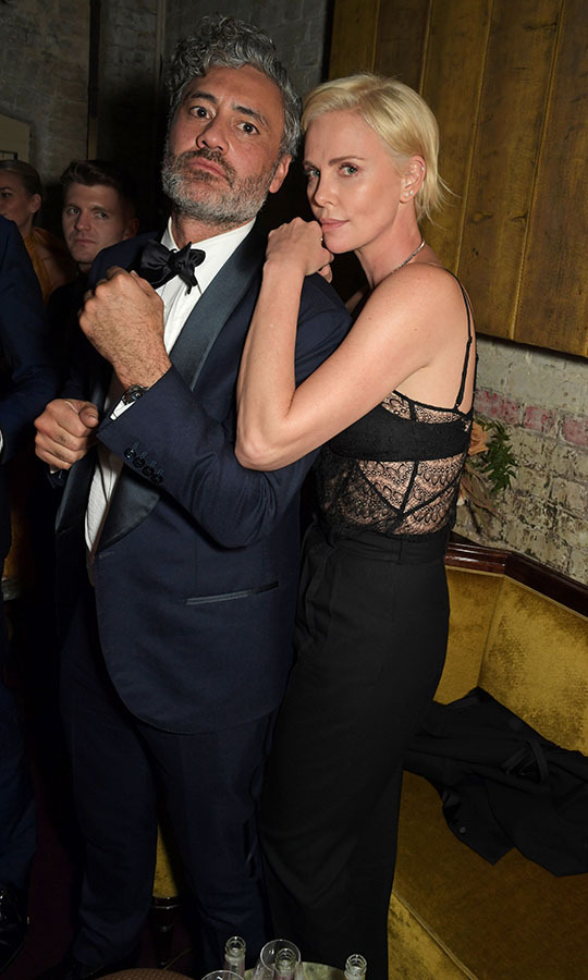 <em>Jojo Rabbit</em> director and BAFTA winner <strong>Taika Waititi</strong> and <a href=/tags/0/charlize-theron><strong>Charlize Theron</strong></a> shared a moment at the Netflix BAFTA after-party at Chiltern Firehouse. <p>Photo: &copy; David M. Benett/Dave Benett/Getty Images for Netflix