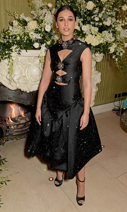 "<em>Aladdin</em> star <strong><a href=""https://ca.hellomagazine.com/tags/0/naomi-scott"">Naomi Scott</strong></a> attended the <em>British Vogue</em> and Tiffany & Co. Fashion and Film Party in a statement-making black dress adorned with galactic embellishment and cut-outs. <p>Photo: &copy; David M. Benett/Dave Benett/Getty Images"