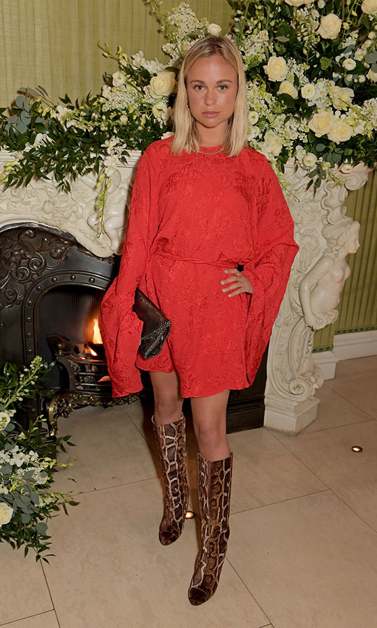 <a href=/tags/0/lady-amelia-windsor><strong>Lady Amelia Windsor</strong></a> made a bold statement in a red dress with dramatic sleeves and tall snakeskin boots at the same BAFTA after-party. <p>Photo: &copy; David M. Benett/Dave Benett/Getty Images