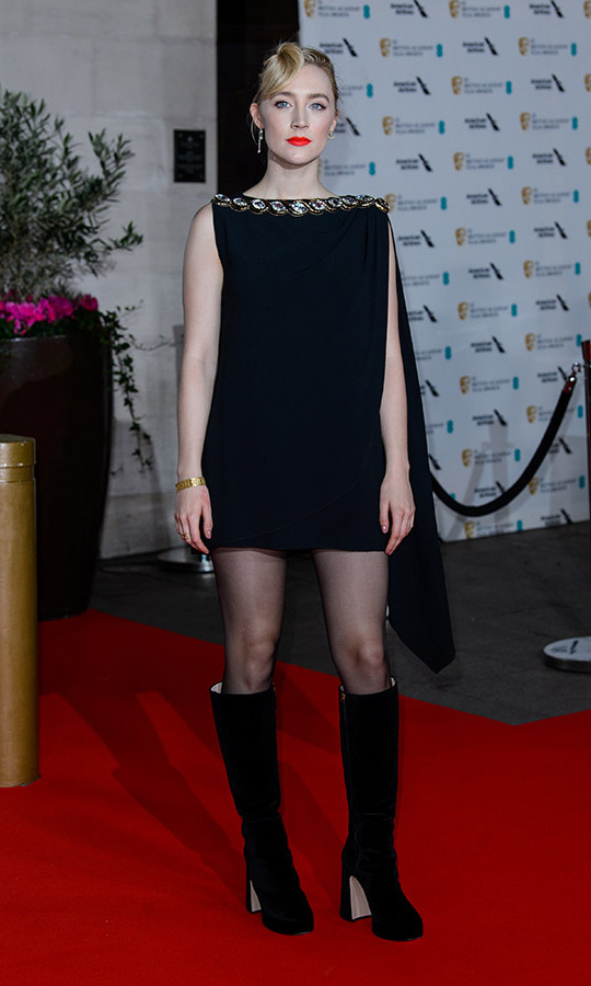 From long to short! <a href=/tags/0/saoirse-ronan><strong>Saoirse Ronan</strong></a> changed from a black maxi gown into a mini dress with embellished neckline to attend the EE British Academy Film Awards 2020 after-party. She kept the electric red-orange lipstick in her second look.<p>Photo: &copy; Joe Maher/WireImage