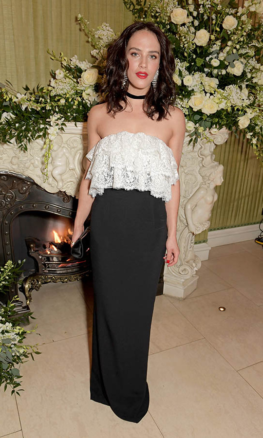 Former <em>Downton Abbey</em> actress <a href=/tags/0/jessica-brown-findlay><strong>Jessica Brown Findlay</a></strong> topped off her black maxi skirt with a white lace strapless top at the same after-party. <p>Photo: &copy; David M. Benett/Dave Benett/Getty Images