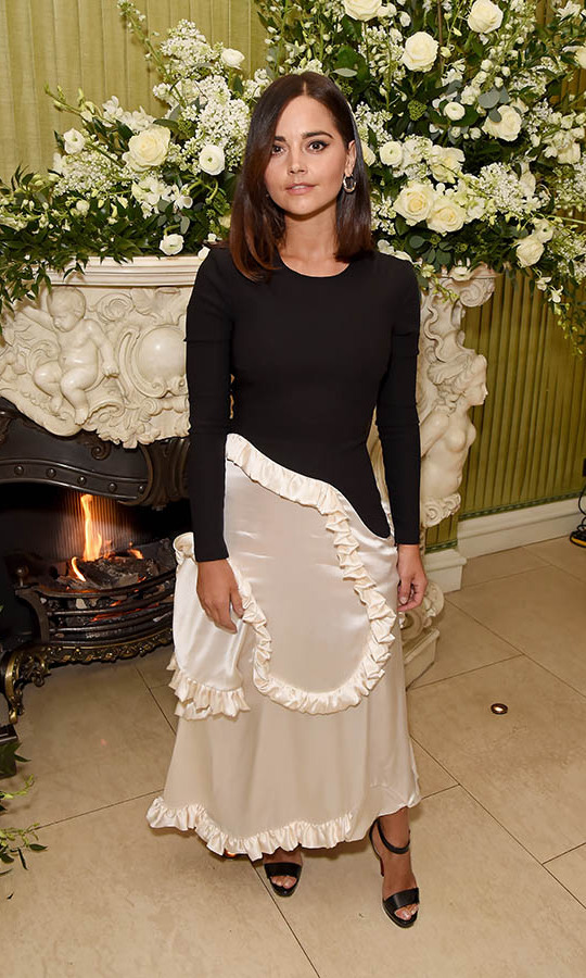 At the same event, <em>Victoria</em> actress <a href=/tags/0/jenna-coleman><strong>Jenna Coleman</strong></a> put a unique spin on black and white with an asymmetrical dress trimmed in swirling frills. <p>Photo: &copy; David M. Benett/Dave Benett/Getty Images