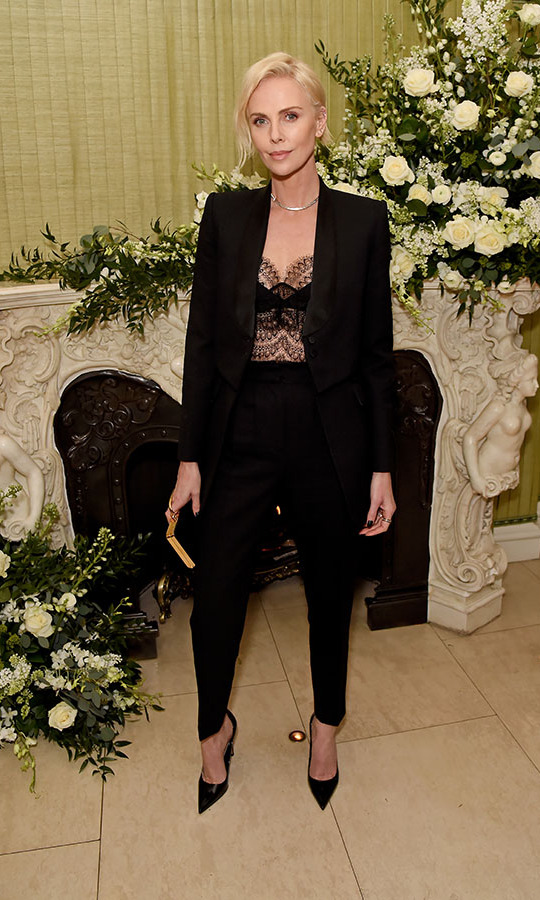 <em>Bombshell</em> actress <a href=/tags/0/charlize-theron><strong>Charlize Theron</strong></a> added a sultry finish to her black suit with a delicate lace top at the <em>British Vogue</em> and Tiffany & Co. Fashion and Film Party. Photo: &copy; David M. Benett/Dave Benett/Getty Images