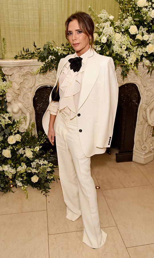 <a href=/tags/0/victoria-beckham><strong>Victoria Beckham</strong></a> defined elegance in a white suit with coordinating ruffled blouse. The look was tied up with a black neck bow.<p>Photo: &copy; David M. Benett/Dave Benett/Getty Images