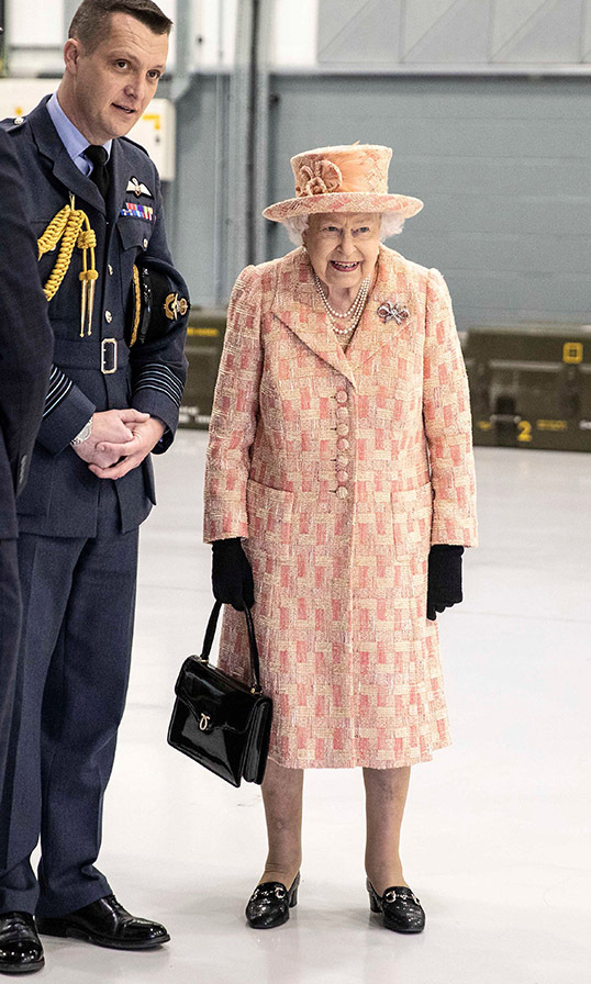 "During her <a href=""https://ca.hellomagazine.com/royalty/2020020384150/the-queen-visits-raf-marham-norfolk/""><strong>first royal engagement of 2020</strong></a>, <a href=/tags/0/queen-elizabeth-ii><strong>the Queen</strong></a> charmed in a peach tweed coat and matching hat by <strong><A href=/tags/0/angela-kelly>Angela Kelly</a></strong>. She finished the look with her signature loafers, black handbag and matching gloves. <p>Her Majesty watched air crew at work on a training model during her visit to the Royal Air Force (RAF) base in Marham, England on Feb. 3.<p>Photo: &copy; RICHARD POHLE/POOL/AFP via Getty Images"