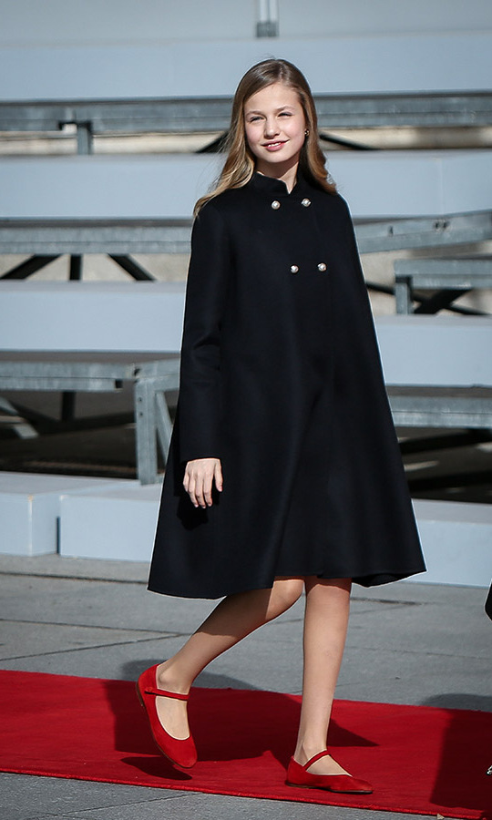 At the same event, <a href=/tags/0/princess-leonor><strong>Princess Leonor</strong></a> added a pop of red to her A-line black coat thanks to her ankle-strap shoes. <p>Photo: &copy; Pablo Cuadra/Getty Images