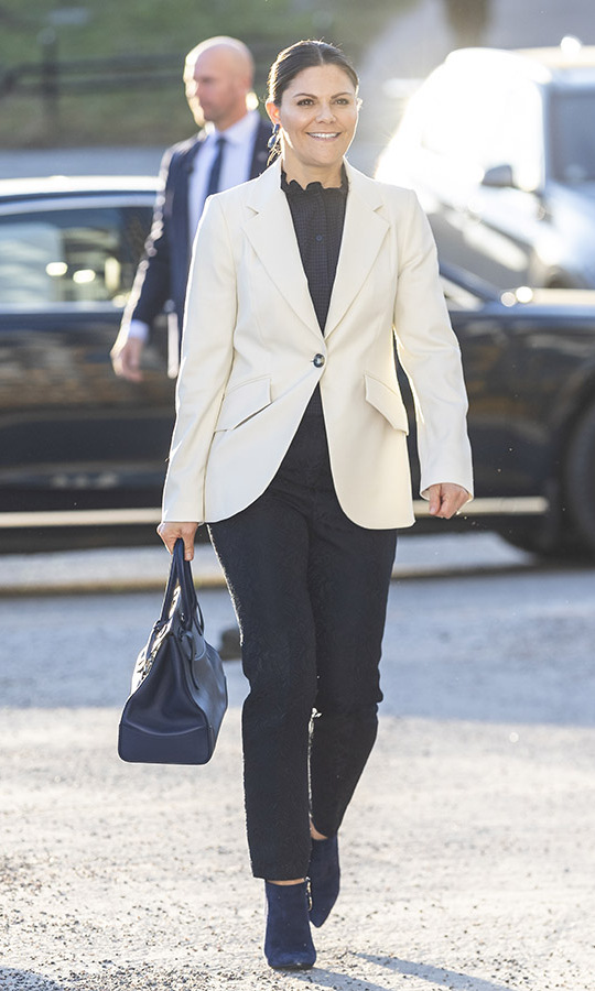 <a href=/tags/0/crown-princess-victoria><strong>Crown Princess Victoria</strong></a> added subtle colour to her black and white look with navy booties, drop earrings and a <a href=/tags/0/ralph-lauren><strong>Ralph Lauren</strong></a> handbag on Feb. 3. She attended a seminar on cancer strategy at the Karolinska Institute in Stockholm. <p>Photo: &copy; Michael Campanella/Getty Images