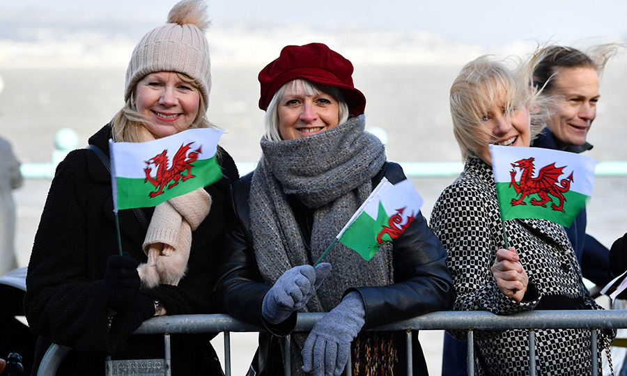 "Plenty of people also carried Wales' flag, the ""Baner Cymru"" or ""Y Ddraig Goch,"" the latter of which means ""red dragon""! 