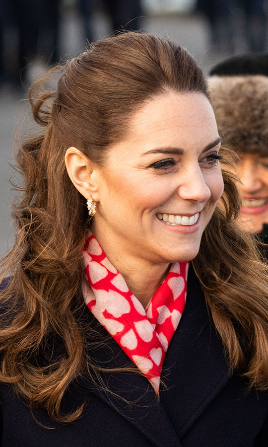Kate was also wearing her <a href=/tags/0/asprey-london>Asprey London</a></strong> oak leaf hoop earrings, and had her hair half down, half up. 