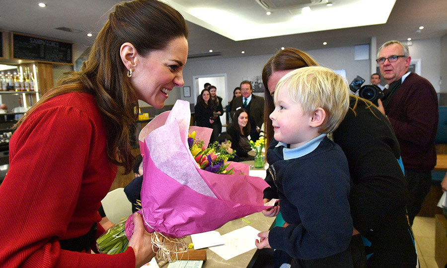 Kate was given even more flowers while there! This sweet little man gave her a big smile as he handed them to her.