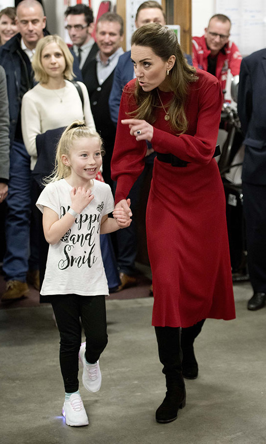 Inside the Bulldogs boxing club in Port Talbot, Kate shed her coat to reveal the long-sleeved Zara red dress. The knitted style was cinched with a black belt, which coordinated with her tall boots. <p>Photo: &copy; Rowan Griffiths - WPA Pool/ Getty Images