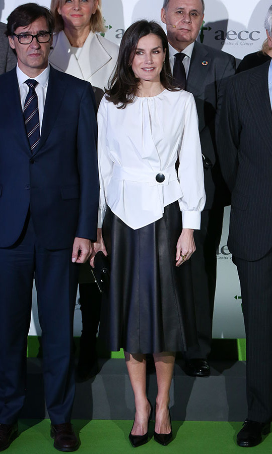 "On Feb. 4, <a href=/tags/0/queen-letizia><strong>Queen Letizia</strong></a> looked simply chic in a white blouse and black pleated leathery skirt at the forum against cancer (""El impacto economico y social del cancer en España"") in Madrid. <p>Photo: &copy; Paolo Blocco/WireImage"