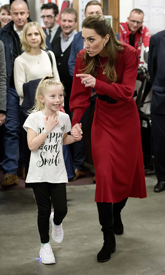 She also grabbed this little one's hand as she toured the centre. So sweet! 