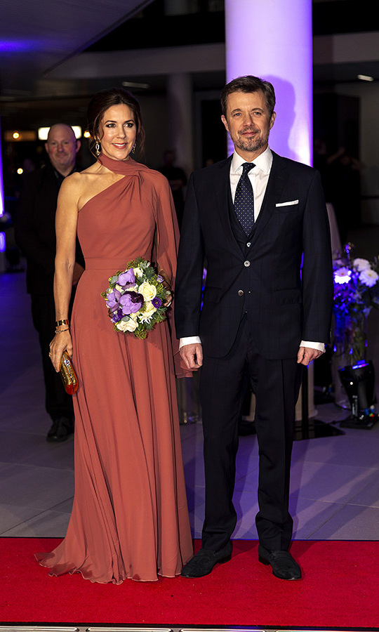 Such glamour! Crown Prince Frederik and Crown Princess Mary looked so elegant at the 2019 Couple's Awards in Denmark. She was fashionable in a one-shouldered russet gown. <p>Photo: &copy; Ole Jensen/Getty Images