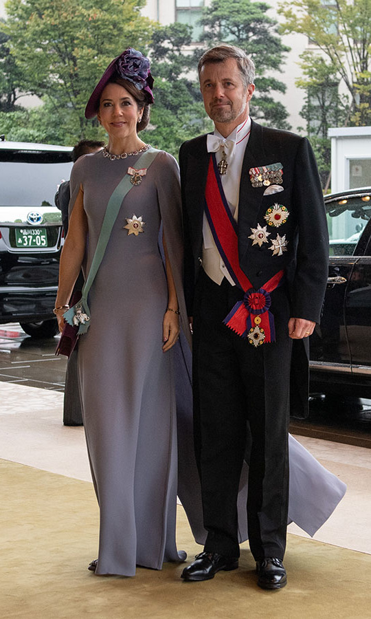 Crown Prince Frederik and Crown Princess Mary were dressed to the nines at the Enthronement Ceremony of <a href=/tags/0/emperor-naruhito><strong>Emperor Naruhito of Japan</strong></a> at the Imperial Palace on Oct. 22, 2019 in Tokyo. She wore a dusty purple gown with cape detail and coordinating floral hat. <p>Photo: &copy; Carl Court/Getty Images
