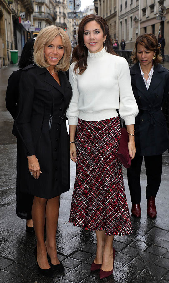 Crown Princess Mary donned a cream sweater and red plaid skirt during a visit to Lamartine School in Paris on Oct. 9, 2019 with French First Lady <strong>Brigitte Macron</strong>.<p>Photo: &copy; Pierre Suu/Getty Images