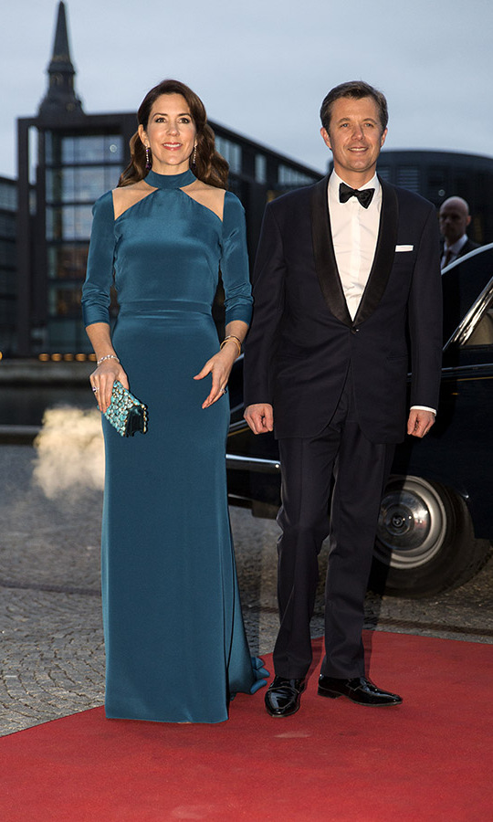 Crown Princess Mary of Denmark looked splendid in a teal gown with neckline cut-outs and a printed clutch. She and Crown Prince Frederik were celebrating <a href=/tags/0/king-philippe><strong>King Philippe</strong></a> and <a href=/tags/0/queen-mathilde><strong>Queen Mathilde</a></strong>'s visit to Denmark in March 2017. <p>Photo: &copy; Ole Jensen - Corbis/Corbis via Getty Images