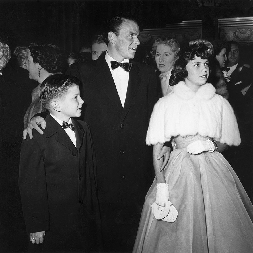 <strong>Frank Sinatra</strong> brought his children, <strong>Frank, Jr.</strong> and <strong>Nancy</strong>, to the 1954 Academy Awards at the RKO Pantages Theatre in New York City. He won the Best Supporting Actor award for his performance in <em>From Here to Eternity</em>. <p>Photo: &copy; Hulton Archive/Getty Images
