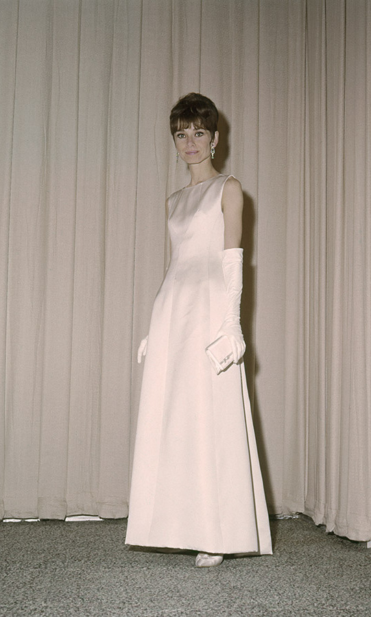 Audrey Hepburn was so elegant at the 37th Academy Awards in Santa Monica, California on April 5, 1965 with her white gown and long gloves. Her film, <em>My Fair Lady</em>, would win a staggering eight Oscars including Best Picture, Best Actor and Best Director. <p>Photo: &copy; Silver Screen Collection/Getty Images