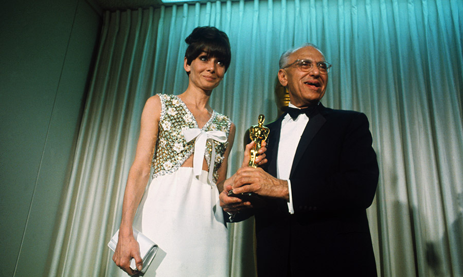 <strong>Audrey Hepburn</strong> appeared onstage with <strong>George Cukor</strong>, who accepted the Best Performance by an Actress award on behalf of <strong>Katharine Hepburn</strong> for <em>Guess Who's Coming to Dinner</em>, at the 1968 Academy Awards. <p>Photo: &copy; Bettmann