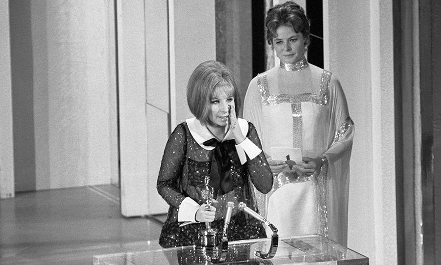 <a href=/tags/0/barbra-streisand><strong>Barbra Streisand</strong></a> reacts to winning the Best Actress Oscar for <em>Funny Girl</em> at the 1969 Academy Awards, after being given the award by <strong>Ingrid Bergman</strong>. It was an especially surprising year because Barbra and <strong>Katharine Hepburn</strong> both received Best Actress awards. It marked the first time the Academy of Motion Picture Arts and Sciences ever gave the award to more than one actress. <p>Photo: &copy; Bettmann