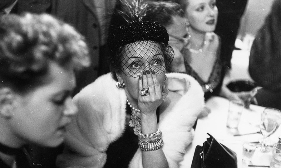 What suspense! Nominee <strong>Gloria Swanson</strong> tensely awaited the results of the Best Actress award at La Zambra nightclub in New York City during a live radio link with the 1951 Oscars ceremony in Los Angeles. <strong>Judy Holliday</strong> (left) would win the prize for <em>Born Yesterday</em>. <p>Photo: &copy; Slim Aarons/Getty Images