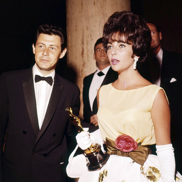 <a href=/tags/0/elizabeth-taylor><strong>Elizabeth Taylor</strong></a> clutches her Oscar for Best Actress for her work in <em>Butterfield 8</em> with then-husband <strong>Eddie Fisher</strong> at the 33rd Academy Awards in Santa Monica on April 1961. <p>Photo: &copy; Silver Screen Collection/Getty Images