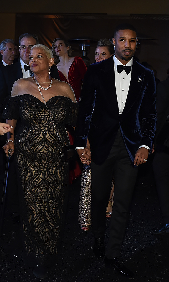 <strong><a href=/tags/0/michael-b-jordan>Michael B. Jordan</a></strong> held his mom <strong>Donna Jordan</strong>'s hand at the Governors Ball after-party in 2019. <I>Black Panther</i> was nominated for Best Picture that year.