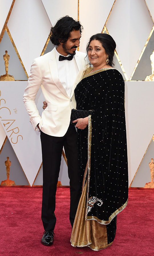 <strong><a href=/tags/0/dev-patel>Dev Patel</a></strong> brought his mom, <Strong>Anita Patel</strong>, with him in 2017, when he was nominated for Best Supporting Actor for his role in <i>Lion</i>.