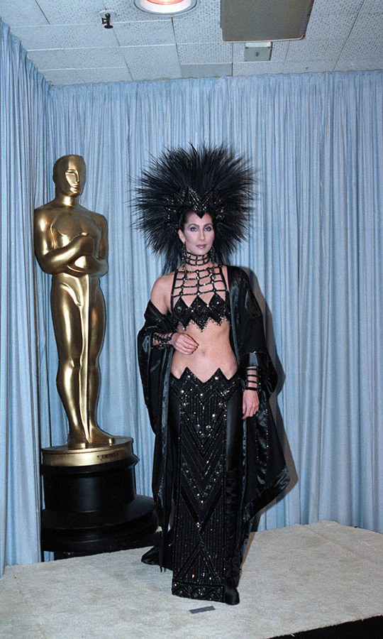 <h2>1986</h2>Cher always knows how to make a style statement! And the singer-actress definitely did at the Academy Awards. She wore a <strong>Bob Mackie</strong> ensemble complete with an oversized feathered headpiece and harness bra top. <p>Photo: &copy; Bettmann