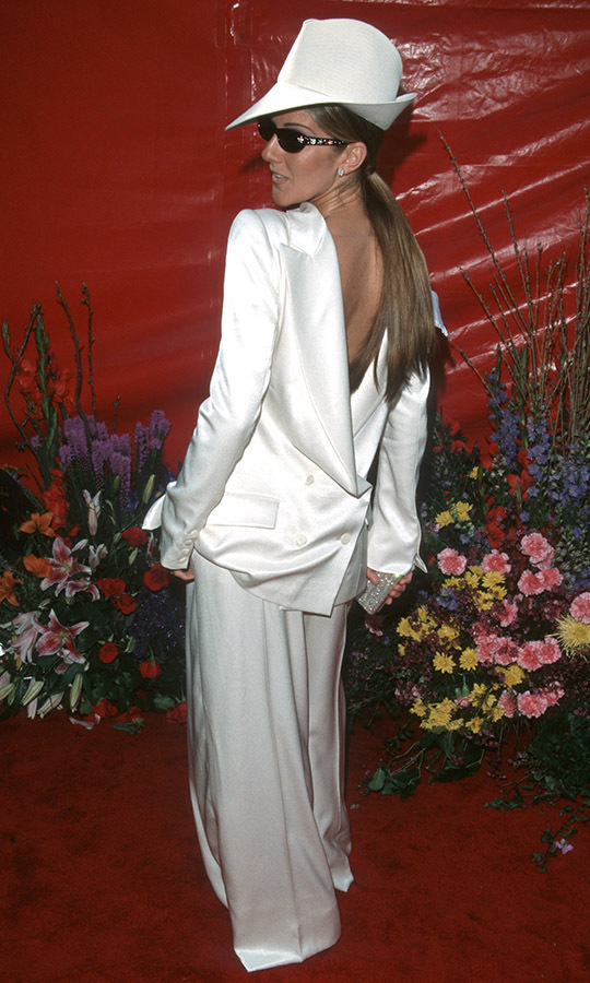 <h2>1999</h2><p>Who says there's one way to wear something? Céline Dion put her own twist on a white suit by wearing the jacket backwards to the 71st Annual Academy Awards. She accessorized the fashion-forward look with a coordinating fedora and sunglasses. <p>Photo: &copy; Jim Smeal/Ron Galella Collection via Getty Images