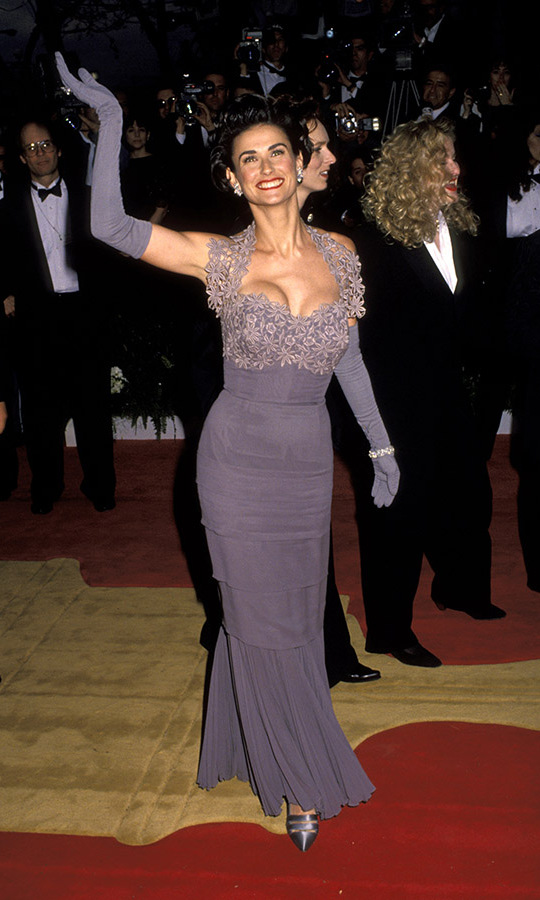 <h2>1992</h2><p><em>A Few Good Men</em>'s <a href=/tags/0/demi-moore><strong>Demi Moore</strong></a> embraced the glamour of the Oscars ceremony in a fitted purple dress with lace bodice and long gloves. <p>Photo: &copy; Jim Smeal/Ron Galella Collection via Getty Images